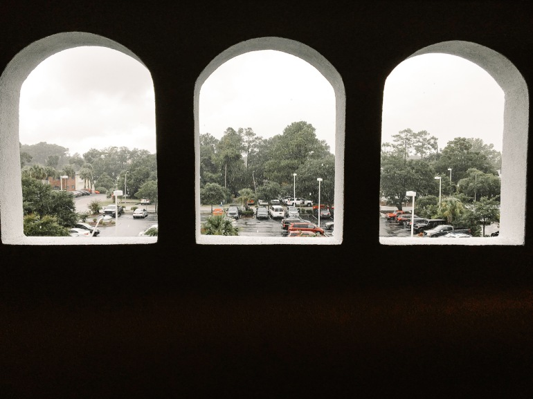 Rain Falling Outside Arch Windows